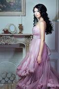 Girl in a magnificent pink dress. - stock photo