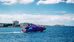 Motorboat leaving sea bay. Ibiza. Balearic Islands, Spain - stock photo