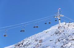 Alpine chairlift in Hintertux - stock photo