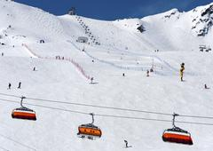 Skiers and chairlift in Solden, Austri - stock photo