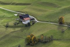 Farmyard meadows autumn coloured trees Welzlach Virgental East Tyrol Austria - stock photo