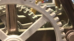 Moving gears of old mechanism close up Stock Footage