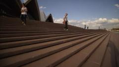 Time lapse fast-motion climbing stairs with tourists to Sydney Opera House Stock Footage