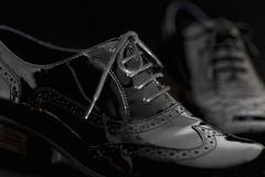 Footwear Concept. Horizontal Image. Pair of black female classic leather shoe - stock photo
