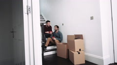 Same sex couple moving in new house, drinking coffee Stock Footage