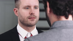 One adult man adjusting tie to his partner - stock footage