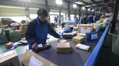 Employees work at the sorting centre of an express company - stock footage