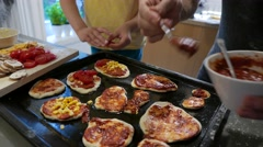 Pizzas topped with corn and tomatoes Stock Footage