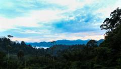 Break of dawn time-lapse with moving clouds at a tropical highland jungle Stock Footage