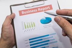 business report and man hand. - stock photo