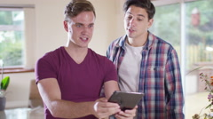 4K Young gay couple pulling faces & taking a selfie with computer tablet Stock Footage