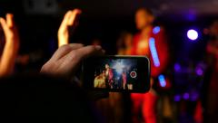 Shooting video of concert dancind performance via smart phone on a stage Stock Footage