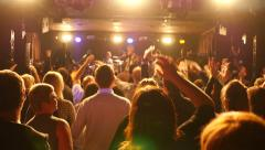 Cheering audience spectators hands up in air enjoy a music concert performance - stock footage