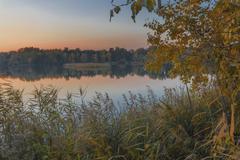 Autumn Evening on the lake - stock photo