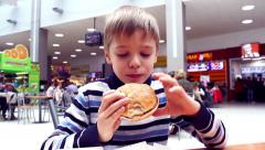 Child eats in the food court Stock Footage
