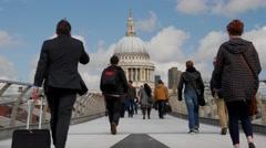 Low angle shot of pedestrians on the Millennium Bridge Stock Footage