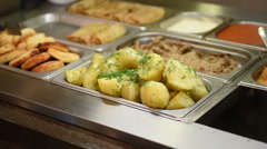 Boiled potato at eatery Stock Footage