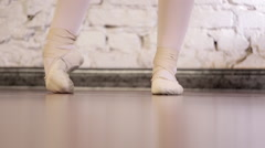Close up of a ballet dancer's feet as she practices point exercises. - stock footage