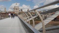 Low angle shot of pedestrians on the Millennium Bridge Stock Footage