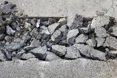 Asphalt demolishing, heap of broken asphalt Stock Photos