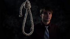 businessman with noose knot or failure. man commit suicide or criminal ready for - stock footage