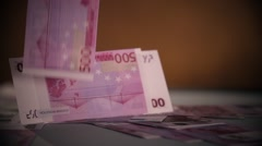 Falling Euro banknotes isolated on black dark background in slow motion 400 fps Stock Footage