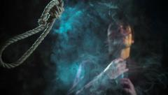 Social commercial. Man smoking cigarette. Noose loop rope for suicide falling Stock Footage