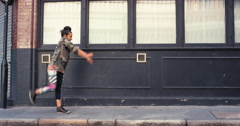 Contemporary funky mixed race woman street dancer dancing freestyle in the city Stock Footage