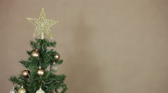 Detail of Christmas tree with golden decorations, pan movement Stock Footage