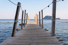 Wooden jetty on Cameo Island, Zakynthos - stock photo