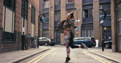Contemporary funky mixed race woman street dancer dancing freestyle in the city - stock footage