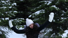 Beautiful girl catch a snowball - stock footage
