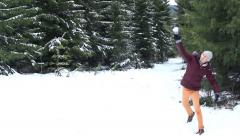 Man throws a snowball in the forest - stock footage