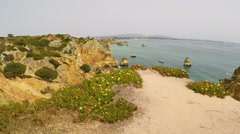 Aerial from natural rocks near Lagos in the Algarve Portugal Stock Footage