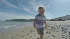 Active child running on the beach in Spain Stock Footage