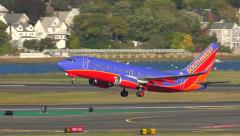 Southwest airplane lifts off the runway - stock footage
