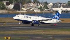JetBlue airplane lifts off the runway. Stock Footage