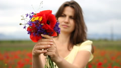 Stock Video Footage of Beautiful woman pick up flower, arrange and offer  a amazing natural bouquet
