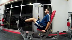 Stock Video Footage of Young man exercises in the gym on the leg press calf extension