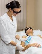 Beautician preparation epilation laser treatment - stock photo
