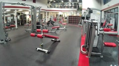 Large empty gym full of fitness equipment Stock Footage
