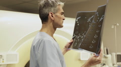 Doctor checking a radiography - stock footage