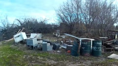 Junk Pile on a piece of farm land Stock Footage