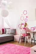 Girly bedroom with wall decoration - stock photo
