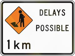 New Zealand road sign - Road workers ahead in 1 kilometre, delays possible Stock Illustration