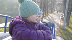 Boy and girl playing in the autumn warm clothing Stock Footage
