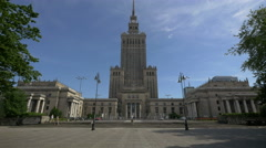 Taking pictures in front of Palace of Culture and Science in Warsaw Stock Footage