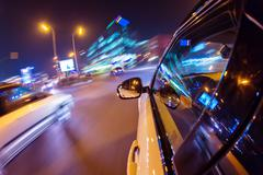 Car driving at night city - stock photo