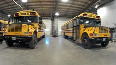 School Buses Parked in the garage Stock Footage