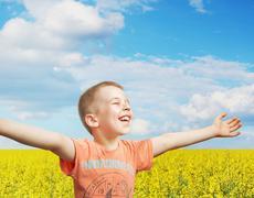 Happy little boy on a summer day Stock Photos